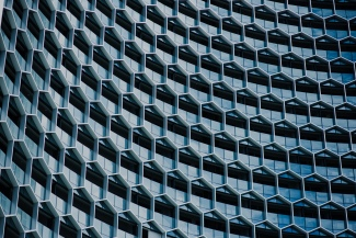 building facade with hexagons photo by chuttersnap